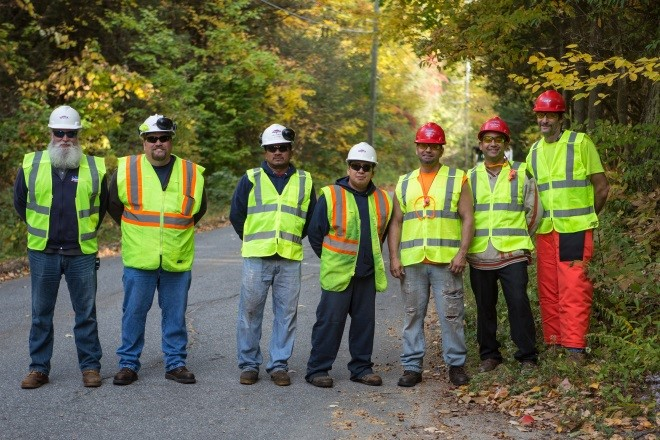 Utility vegetation management services Lewis Tree Service crew group photo pose